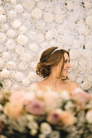 Bride at Top Table Flower Back Drop | The Orangery Maidstone | Lucie Watson Photography | TDH Media Films