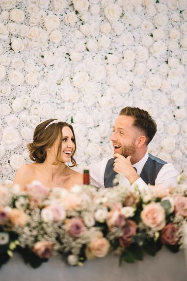 Top Table Decor | Bride in Ronald Joyce Wedding Dress | Groom in Grey Moss Bros Suit | The Orangery Maidstone | Lucie Watson Photography | TDH Media Films