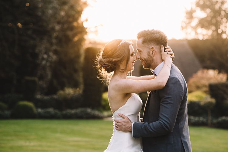 Sunset | Bride in Ronald Joyce Bridal Gown | Groom in Grey Moss Bros Suit | The Orangery Maidstone | Lucie Watson Photography | TDH Media Films