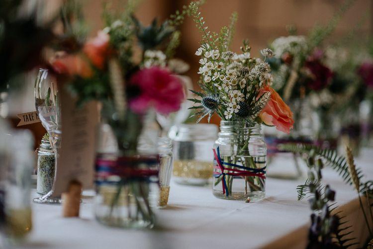 Jam Jar Flowers At Wedding