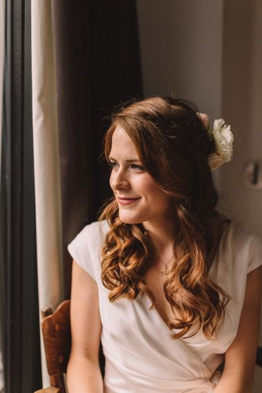 Bride With Fresh Flowers In Her Hair