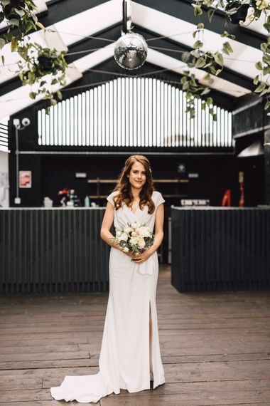 Bride in Coast Wedding Dress