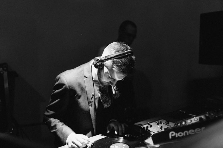 Groom DJing on Wedding Day
