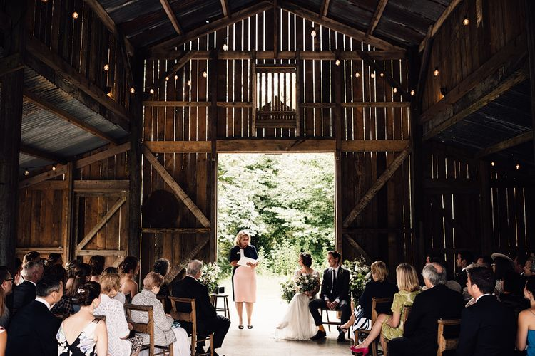 Wedding Ceremony | Bride in Catherine Deane Gown | Groom in Grey Edit Suits Suit | Rustic Barn Wedding at Nancarrow Farm, Cornwall | Samuel Docker Photography