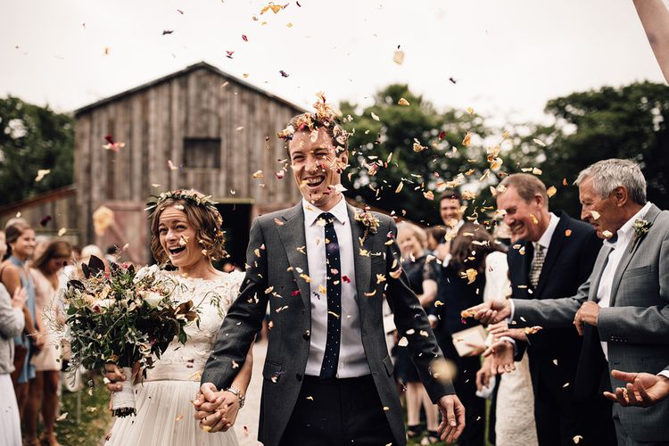Confetti Exit | Bride in Catherine Deane Gown | Groom in Grey Edit Suits Suit | Rustic Barn Wedding at Nancarrow Farm, Cornwall | Samuel Docker Photography