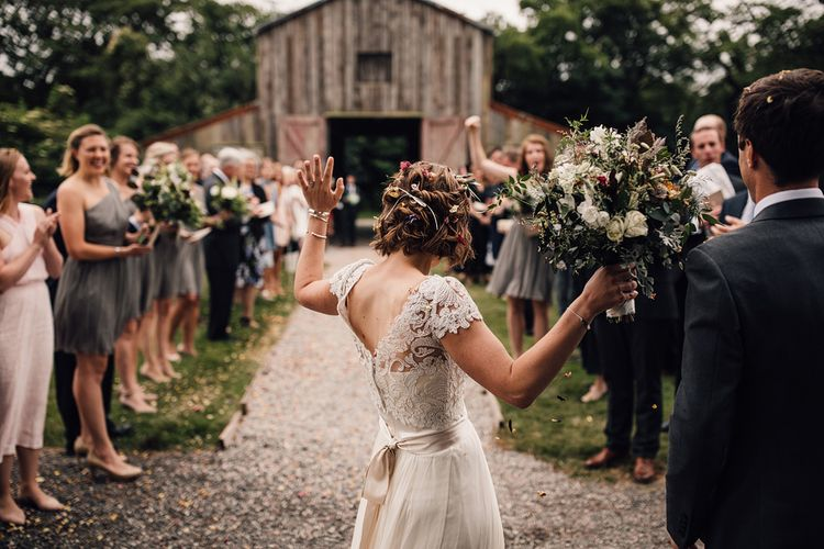 Confetti Exit | Bride in Catherine Deane Gown | Rustic Barn Wedding at Nancarrow Farm, Cornwall | Samuel Docker Photography