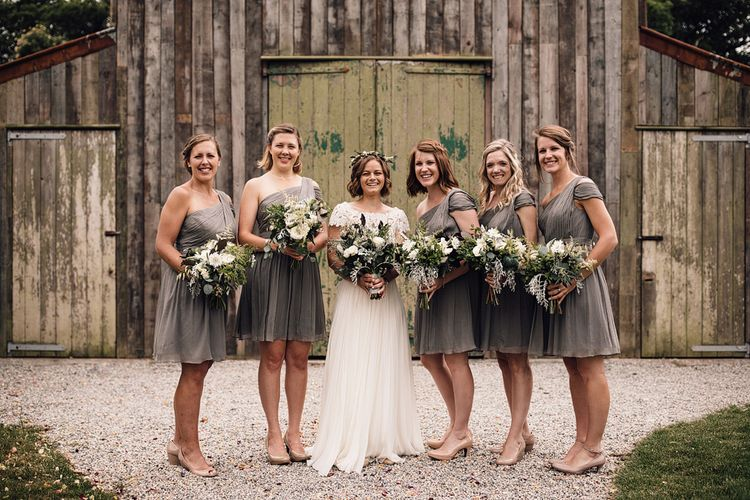 Bridesmaids in Grey One Shoulder JCrew Dresses | Bride in Catherine Deane Wedding Dress | Rustic Barn Wedding at Nancarrow Farm, Cornwall | Samuel Docker Photography