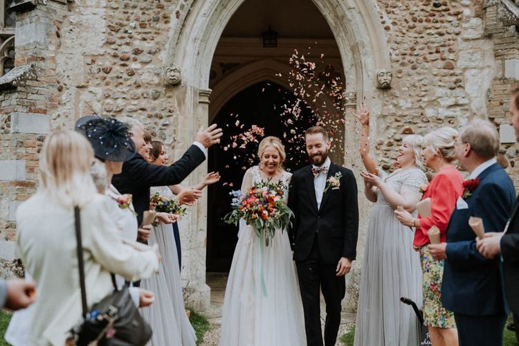 Church Wedding Ceremony | Bride in Lace & Tulle Gown | Groom in Black Suit & Liberty Print Bow Tie | Colourful DIY Barn Wedding at The Manor Barn, Cambridge | Meghan Lorna Photography