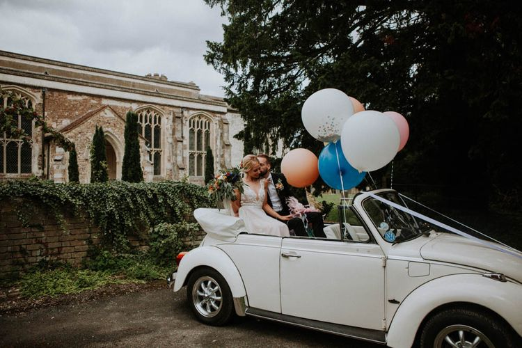 Giant Balloons | Bride in Lace & Tulle Gown | Groom in Suit & Bow Tie | Colourful DIY Barn Wedding at The Manor Barn, Cambridge | Meghan Lorna Photography