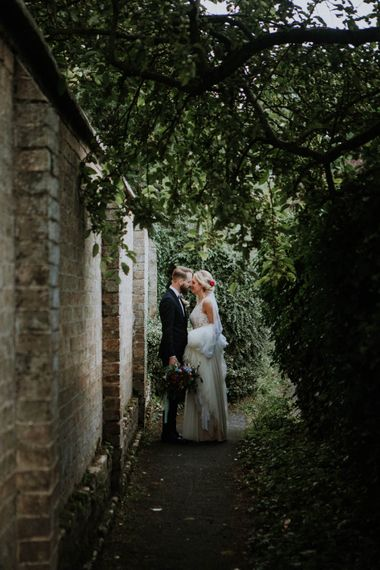 Bride in Lace & Tulle Gown | Groom in Black Suit & Liberty Print Bow Tie | Colourful DIY Barn Wedding at The Manor Barn, Cambridge | Meghan Lorna Photography