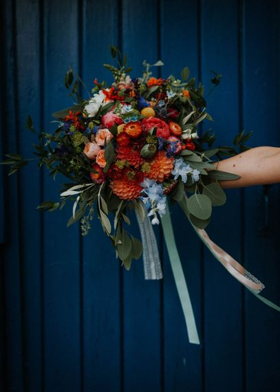 Red & Orange Wedding Bouqet with Dahlias & Ribbons | Colourful DIY Barn Wedding at The Manor Barn, Cambridge | Meghan Lorna Photography