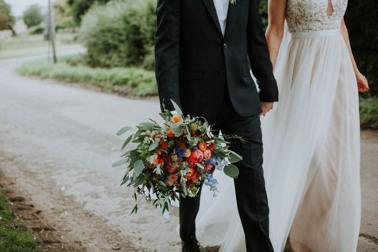 Bride Bridal Bouquet | Bride in Lace & Tulle Gown | Groom in Black Suit & Liberty Print Bow Tie | Colourful DIY Barn Wedding at The Manor Barn, Cambridge | Meghan Lorna Photography