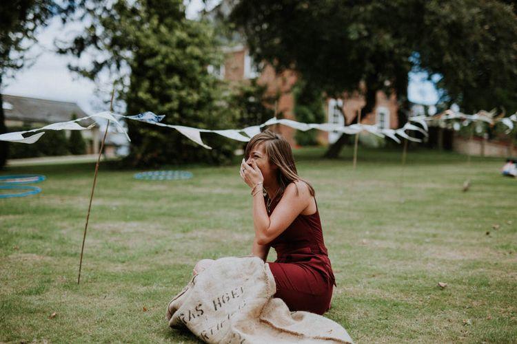 Sack Race Garden Games | Colourful DIY Barn Wedding at The Manor Barn, Cambridge | Meghan Lorna Photography