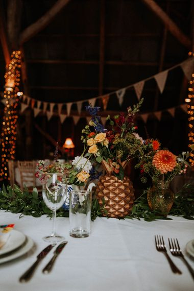 Flower Stems in Spray Painted Pineapple Centrepiece | Colourful DIY Barn Wedding at The Manor Barn, Cambridge | Meghan Lorna Photography