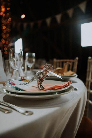 Spray Painted Dinosaur Place Setting | Colourful DIY Barn Wedding at The Manor Barn, Cambridge | Meghan Lorna Photography