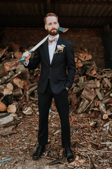 Groom in Black Suit & Liberty Print Bow Tie | Colourful DIY Barn Wedding at The Manor Barn, Cambridge | Meghan Lorna Photography
