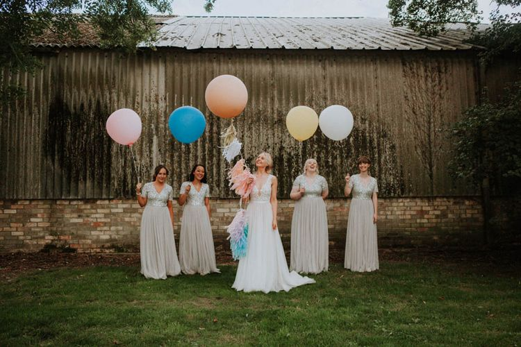 Giant Balloons | Bride in Lace Wedding Dress | Bridesmaids in Pale Blue ASOS Dresses | Colourful DIY Barn Wedding at The Manor Barn, Cambridge | Meghan Lorna Photography