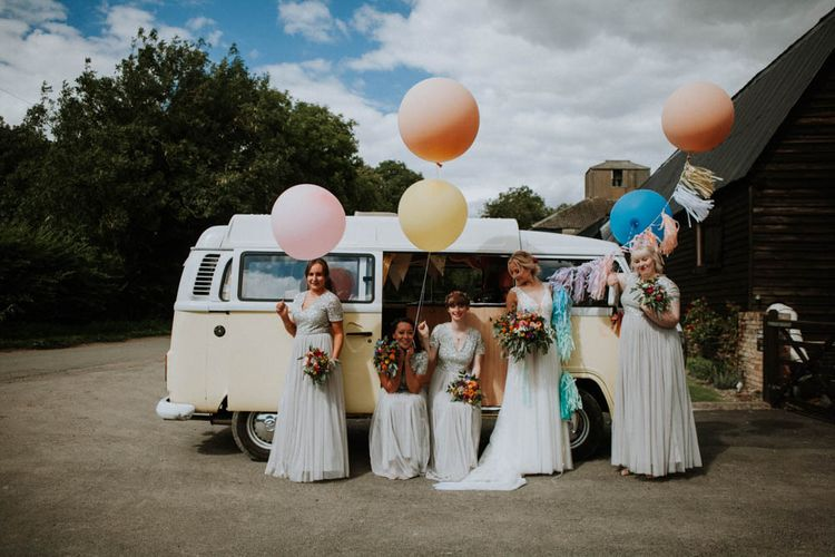 Giant Balloons | Colourful DIY Barn Wedding at The Manor Barn, Cambridge | Bride in Lace Wedding Dress | Bridesmaids in Pale Blue ASOS Dresses | Meghan Lorna Photography