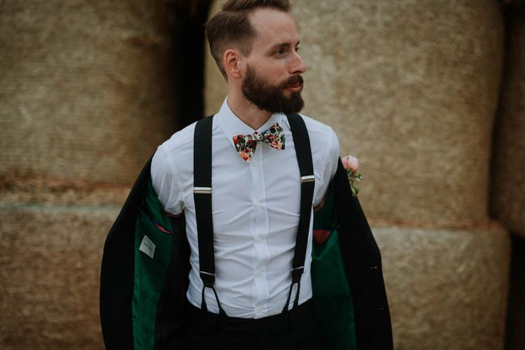 Groom in Liberty Print Bow Tie & Braces | Colourful DIY Barn Wedding at The Manor Barn, Cambridge | Meghan Lorna Photography