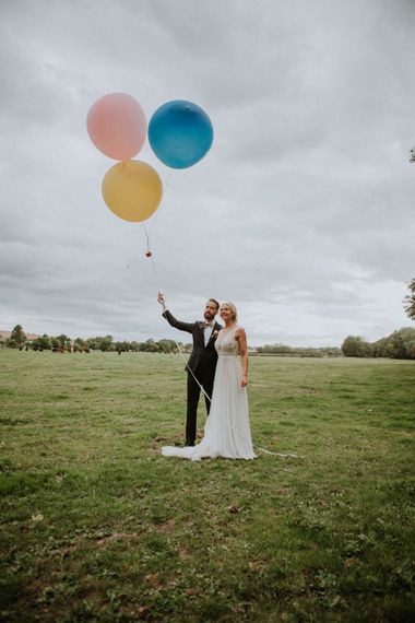 Giant Balloons | Bride in Illusion Lace & Tulle Wedding Dress | Groom in Bow Tie | Colourful DIY Barn Wedding at The Manor Barn, Cambridge | Meghan Lorna Photography