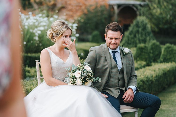 Bride in Phil Collins Bridal Gown for an Outdoor Wedding Ceremony