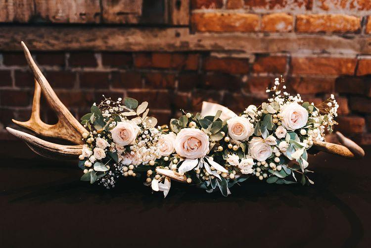 Antler Wedding Decor Adorned with Pink Roses