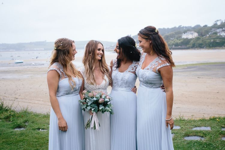 Bridesmaids In Powder Blue Coast Dresses // White Vintage Wedding Car // Coco By Anna Campbell For A Coastal Marquee Wedding In Cornwall With Styling By The Artful Event Co And Prop Hire Inspire Hire With Film By Baxter & Ted And Images From A Thing Like That