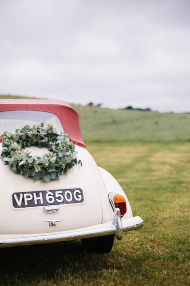 White Vintage Wedding Car // Coco By Anna Campbell For A Coastal Marquee Wedding In Cornwall With Styling By The Artful Event Co And Prop Hire Inspire Hire With Film By Baxter & Ted And Images From A Thing Like That