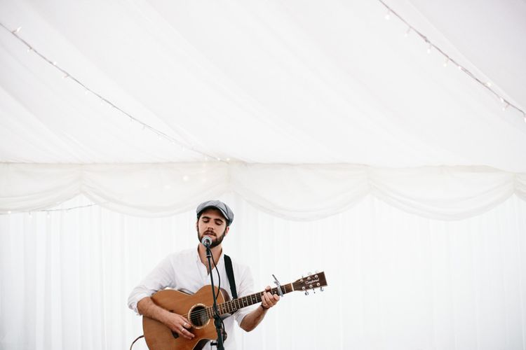 Guitarist Wedding Musician // Coco By Anna Campbell For A Coastal Marquee Wedding In Cornwall With Styling By The Artful Event Co And Prop Hire Inspire Hire With Film By Baxter & Ted And Images From A Thing Like That