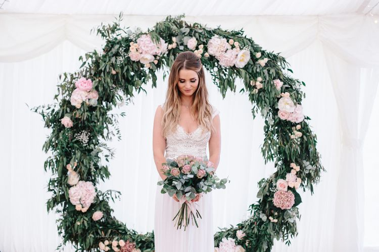 Floral Moongate Wedding Photobooth Backdrop // Coco By Anna Campbell For A Coastal Marquee Wedding In Cornwall With Styling By The Artful Event Co And Prop Hire Inspire Hire With Film By Baxter & Ted And Images From A Thing Like That