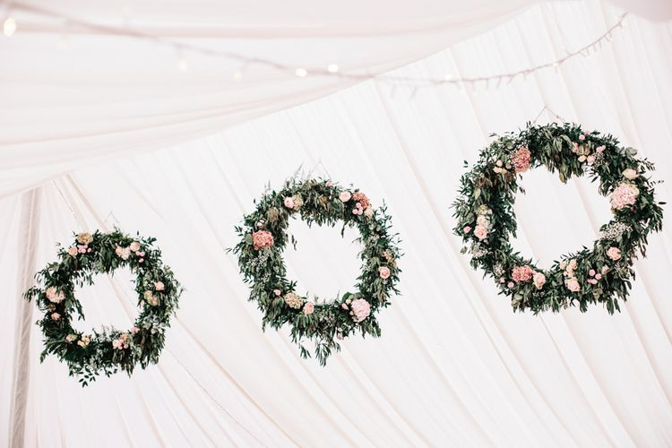 Floral Hoop Marquee Wedding Decor // Coco By Anna Campbell For A Coastal Marquee Wedding In Cornwall With Styling By The Artful Event Co And Prop Hire Inspire Hire With Film By Baxter & Ted And Images From A Thing Like That