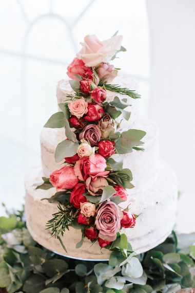 Wedding Cake With Fresh Flowers // Coco By Anna Campbell For A Coastal Marquee Wedding In Cornwall With Styling By The Artful Event Co And Prop Hire Inspire Hire With Film By Baxter & Ted And Images From A Thing Like That