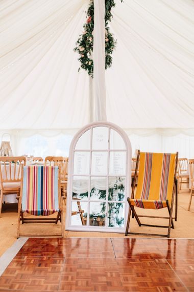 Wedding Seating Area With Deckchairs // Powder Blue Coast Bridesmaids Dresses // Coco By Anna Campbell For A Coastal Marquee Wedding In Cornwall With Styling By The Artful Event Co And Prop Hire Inspire Hire With Film By Baxter & Ted And Images From A Thing Like That