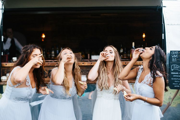 Powder Blue Coast Bridesmaids Dresses // Coco By Anna Campbell For A Coastal Marquee Wedding In Cornwall With Styling By The Artful Event Co And Prop Hire Inspire Hire With Film By Baxter & Ted And Images From A Thing Like That