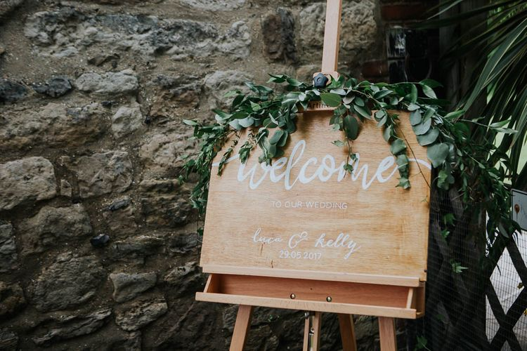Wooden Welcome Sign with Greenery | | Cooling Castle Barn Wedding | Michelle Cordner Photography