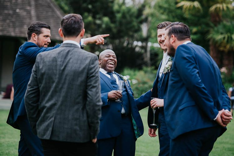 Groomsmen in Ted Baker Suits from Moss Bros | Cooling Castle Barn Wedding | Michelle Cordner Photography