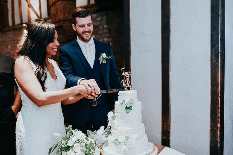 Cutting The Cake | Bride in Lace Mori Lee Gown | Groom in Ted Baker Suit | Cooling Castle Barn Wedding | Michelle Cordner Photography