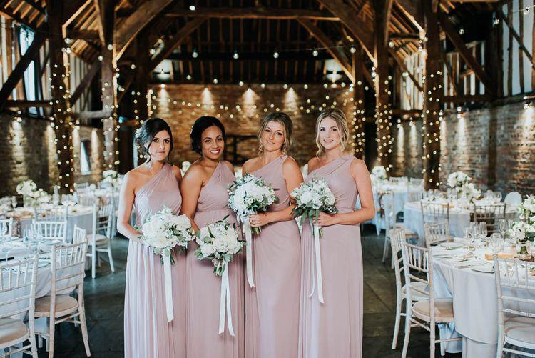 Bridesmaids in Dusky Pink One Shoulder Dresses from Davids Bridal | Cooling Castle Barn Wedding | Michelle Cordner Photography