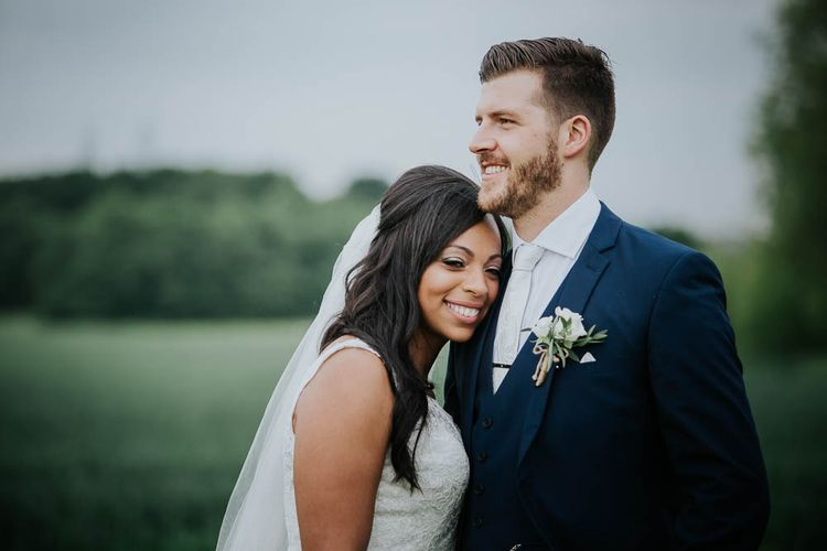 Bride in Mori Lee Gown | Groom in Ted Baker Suit from Moss Bros | Cooling Castle Barn Wedding | Michelle Cordner Photography