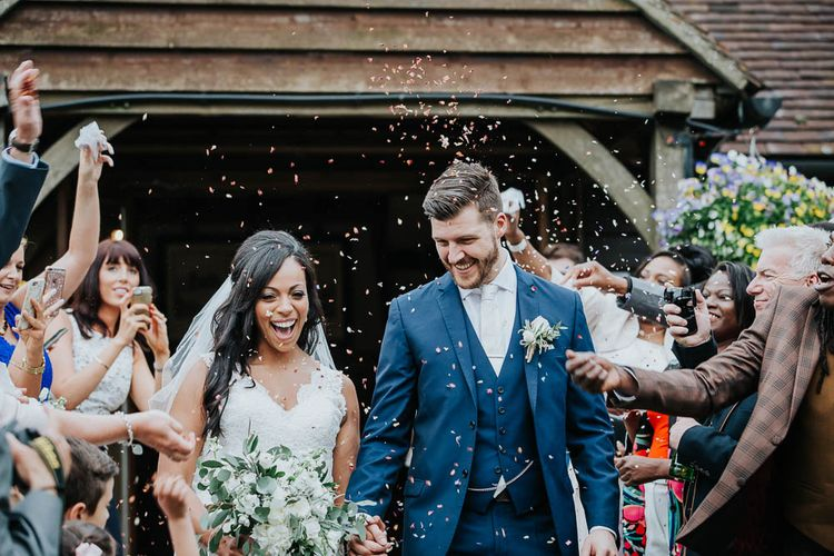 Confetti Moment | Bride in Mori Lee Gown | Groom in Ted Baker Suit from Moss Bros | Cooling Castle Barn Wedding | Michelle Cordner Photography