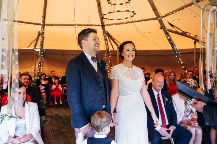 Wedding Ceremony | Bride in Lenora Watters Wtoo Lace Bridal Gown | Groom in Ted Baker Chinos & Reiss Waistcoat & Blazer | Bohemian Tipi Wedding Weekend at Fforest, Wales | Naomi Jane Photography