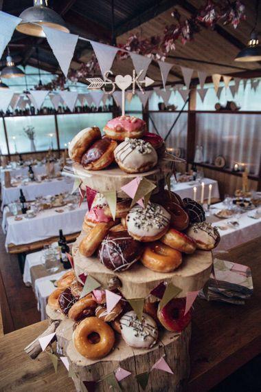 Krispy Kreme Doughnut Tower Wedding Cake | Bohemian Tipi Wedding Weekend at Fforest, Wales | Naomi Jane Photography