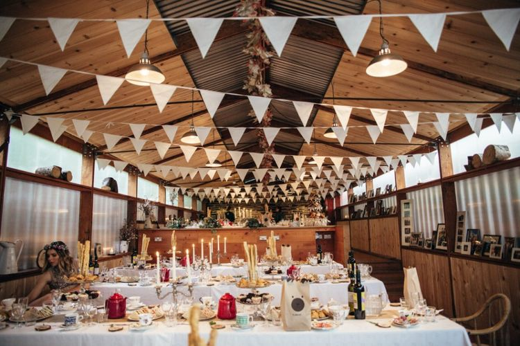 Reception with Bunting Decor | Bohemian Tipi Wedding Weekend at Fforest, Wales | Naomi Jane Photography
