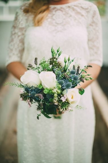 Wedding Bouquet With Blue Thistles And White Blooms