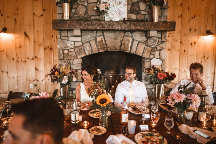 Top Table   Fireplace Backdrop   Wild Flower Decor   Outdoor Wedding at Claxton Farm in Weaverville, North Carolina   Benjamin Wheeler Photography