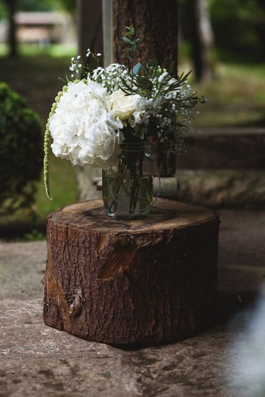 Rustic Tree Stump and Flowers in Vase Aisle Decor