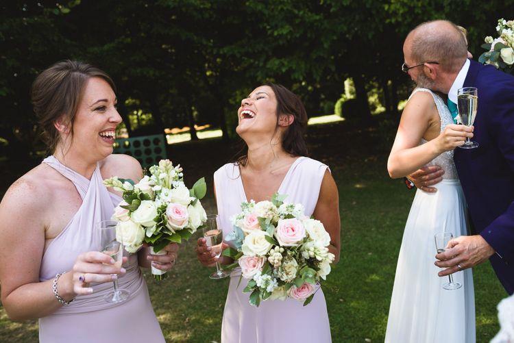 Bridesmaids in Blush Pink Maxi Corwin Coast Wrap Dress