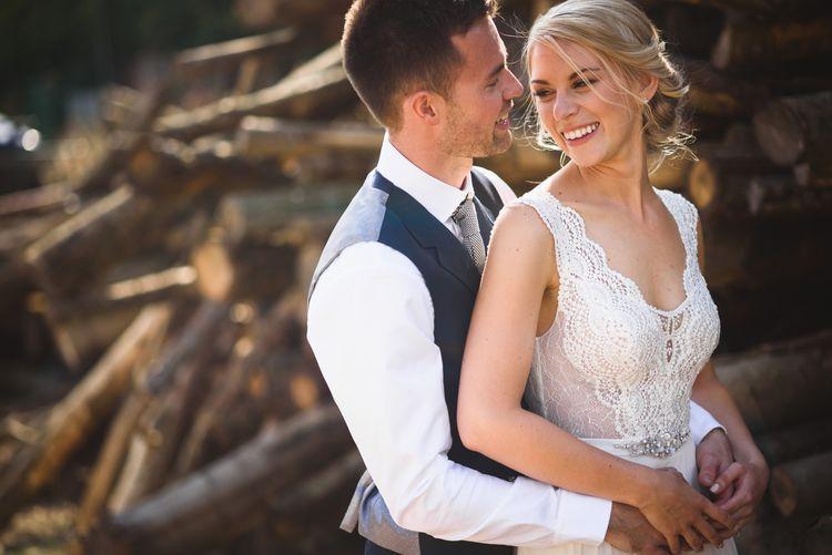 Bride in Flora 'Madlen' Wedding Dress from Blackburn Bridal Boutique and Groom in Ted Baker Suit