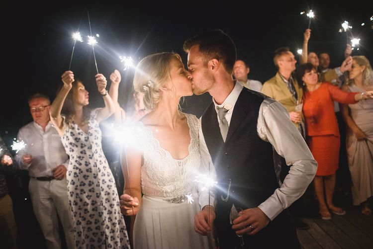 Sparkler Exit with Bride in Flora 'Madlen' Wedding Dress from Blackburn Bridal Boutique and Groom in Ted Baker Suit