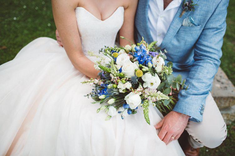 Blue & White Bouquet   Bride in Lyn Ashworth Wedding Dress   Groom in Blue Jacket   Outdoor Wedding at Borgo Bastia Creti in Italy   Paolo Ceritano Photography